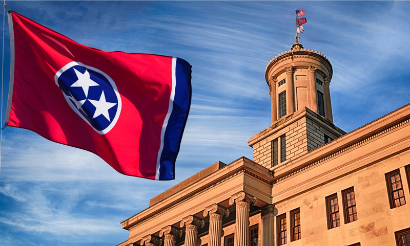 Tennessee State Capitol building with State flag flying in front