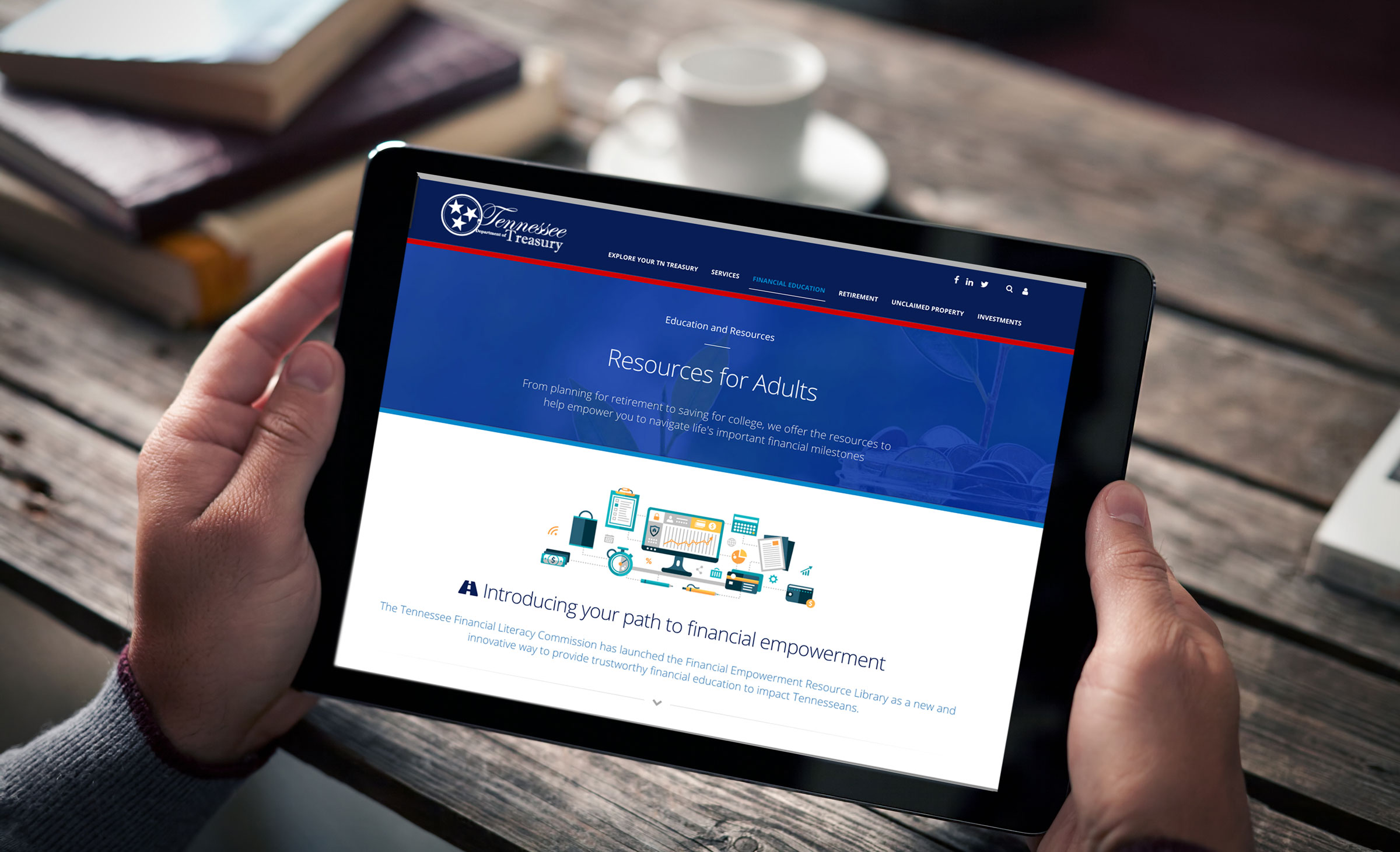 man drinking coffee with tablet showing Tennessee Treasury financial education site