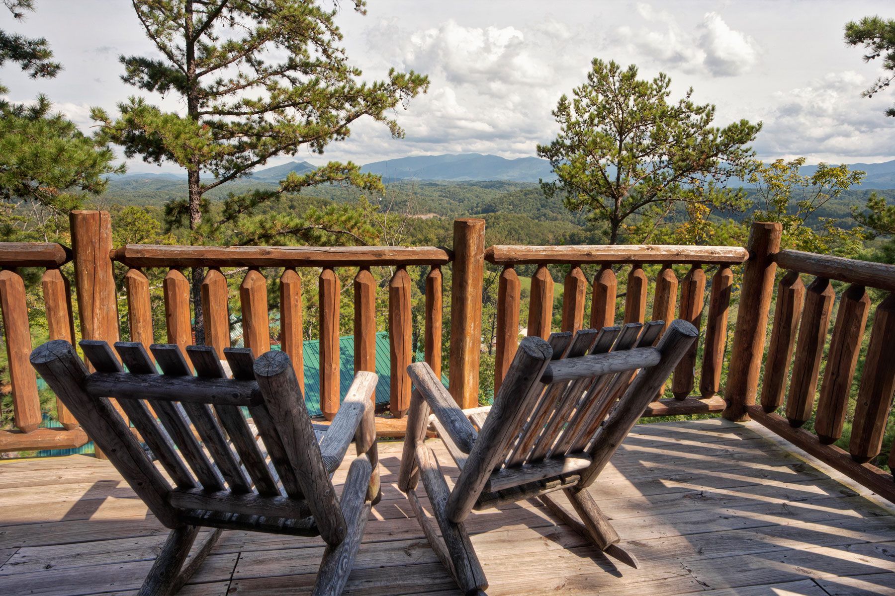 wooden chairs overlooking mountains