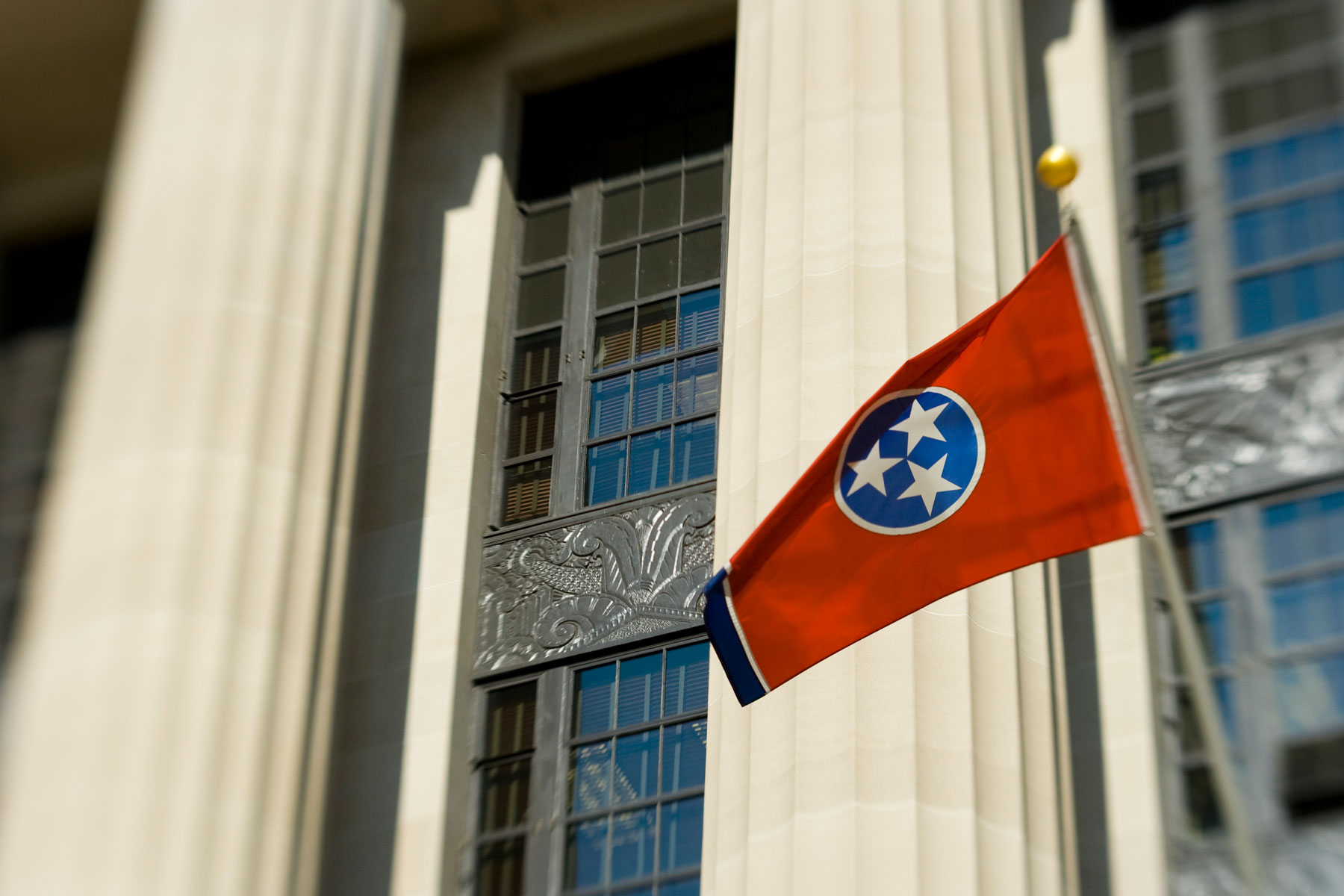 Tennessee state flag in front of government building