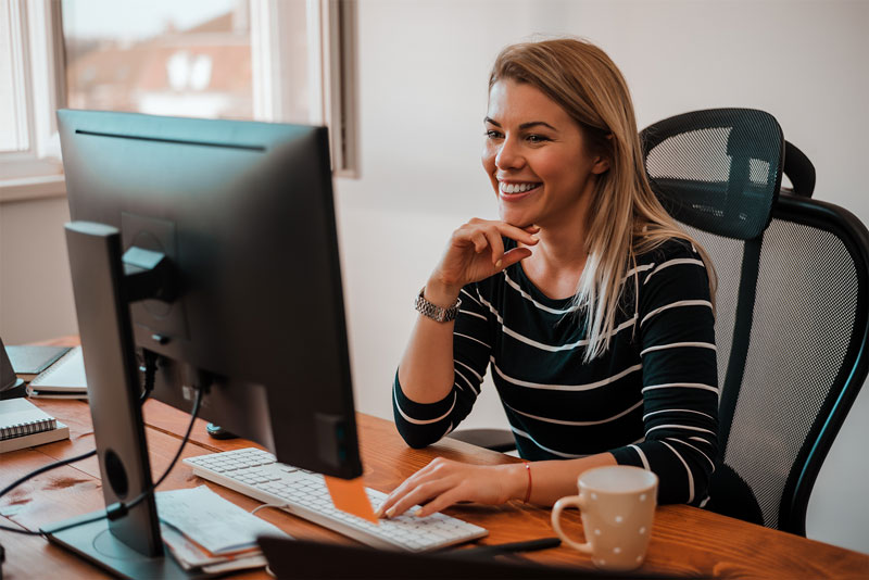 female employer on computer in modern office setting