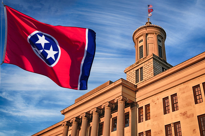Tennessee state flag in front of the capitol building