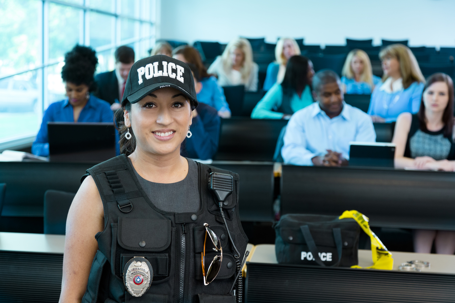 Female police officer in front of classroom