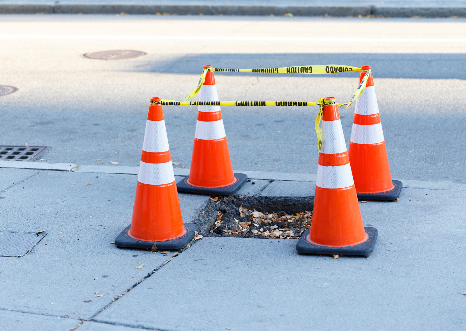 pothole surrounded by cones