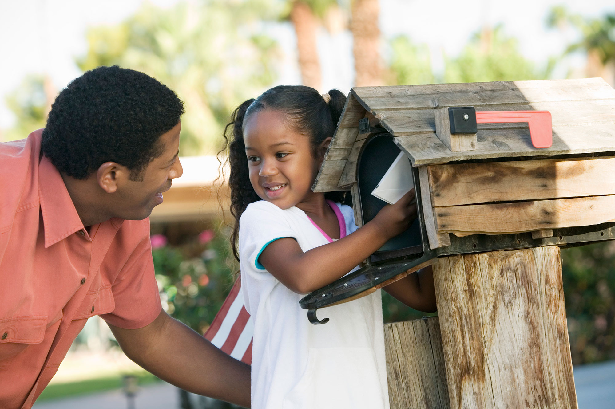 Father and daughter checking mailbox