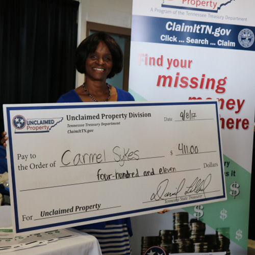 TN unclaimed property claimant with check