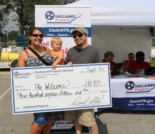 family with unclaimed property check at ClaimItTN.gov event