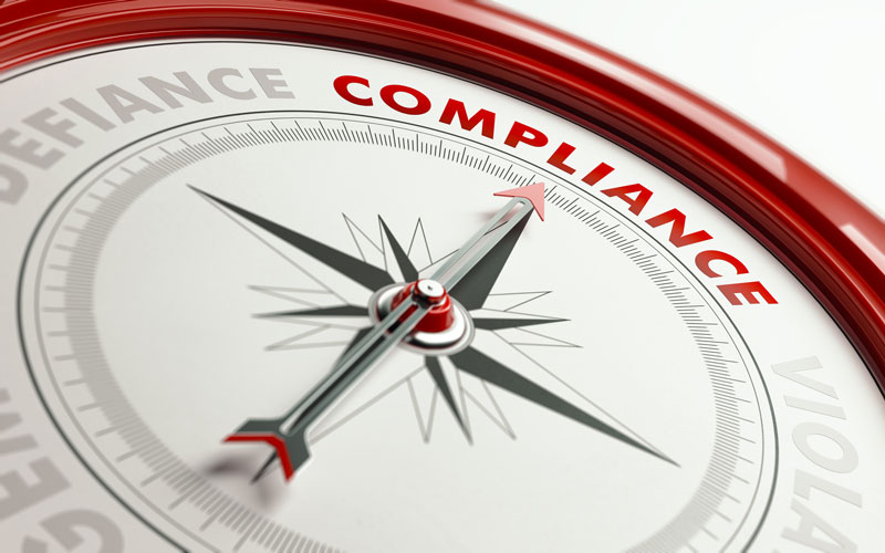 compass with needle pointing toward the word Compliance