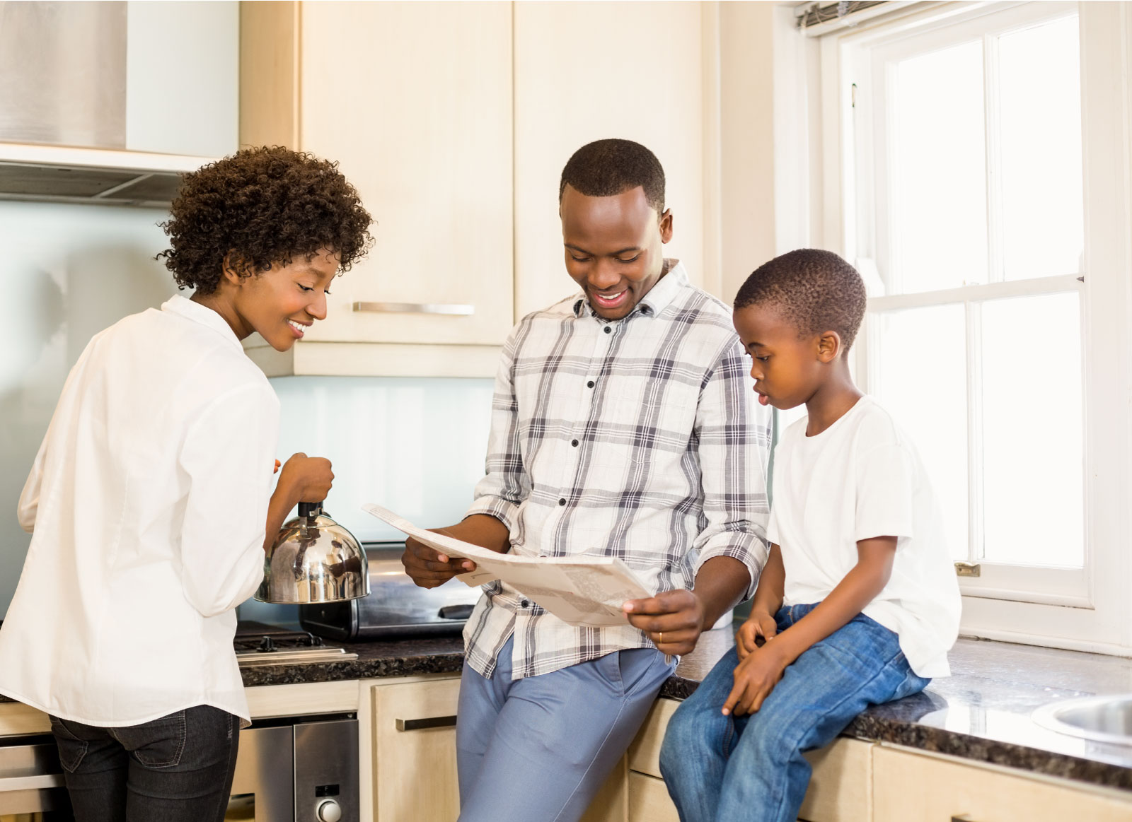 Family in kitchen reading unclaimed property names in local newspaper