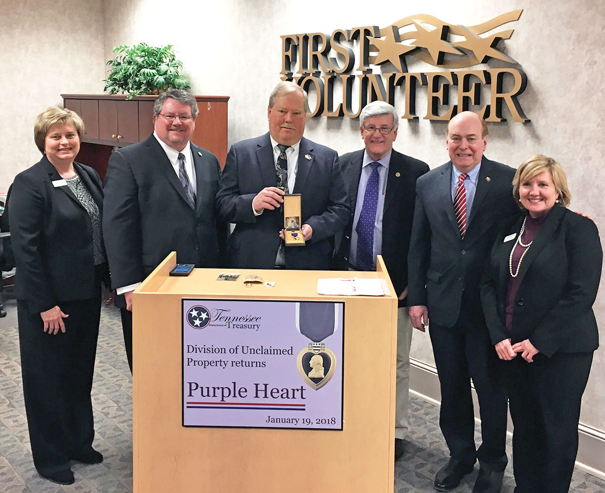 Treasurer Lillard and representatives from the Unclaimed Property team return a Purple Heart to the family of a war hero